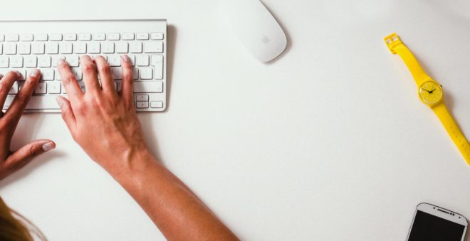 hands on a white keyboard